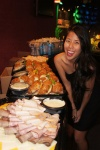 Megan next to our great spread of yummy food!