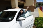 Paulette posing in the 2012 VW Passat on hand for the chance for one lucky person to win, courtesy of Volkswagen Honolulu