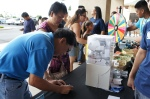 Participants signing up for a chance to win a new Apple ipad2