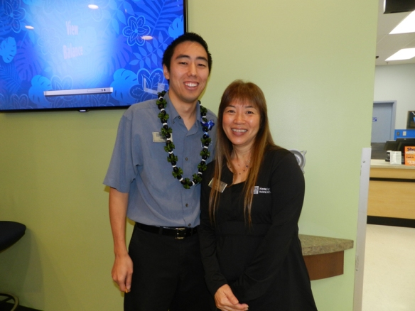 Mililani Branch Manager Micah and Teller Operations Manager Margie celebrate this great day